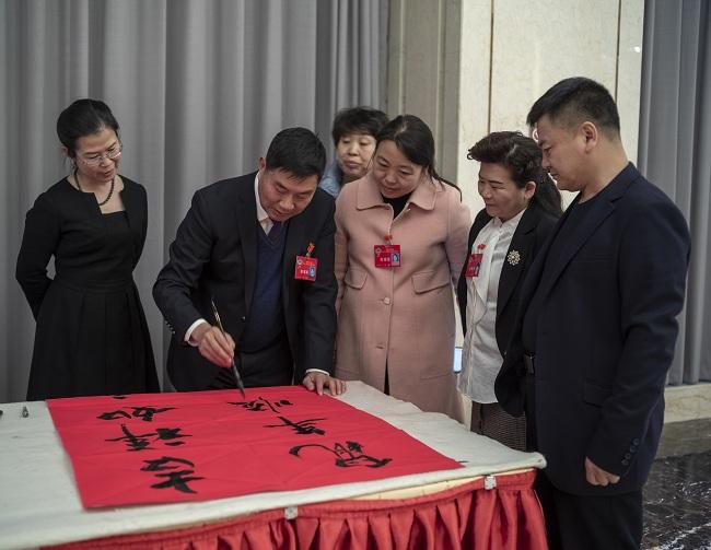 ——记政协会议上的民建会员李春景-1.jpg